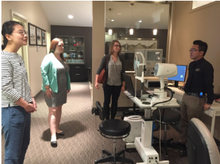 Jonathan Dinh (4th year optometry intern) gives a clinic tour to Mentorship participants from left: Angela Zhang (1st year), Madilyne Kevany (1st year) and Amanda Stout (4th year). (Photo Credit: Courtney Fan)